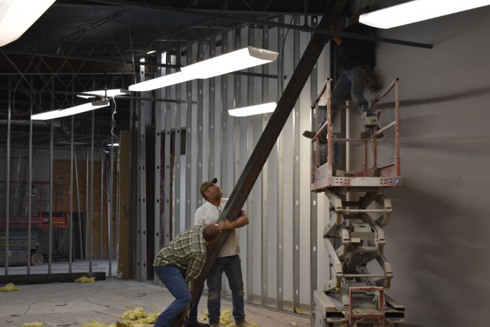 """Workers """"raising the roof"""" in the Museum's new Mary Bratton Curtis Gallery (January, 2017)."""