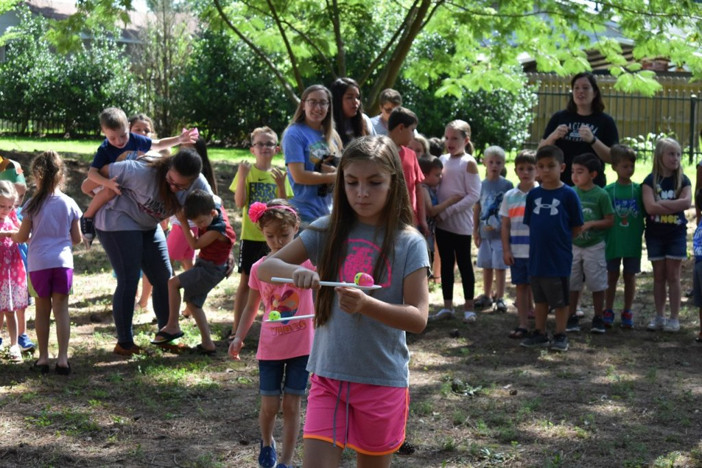 Dino Campers participating in an egg race
