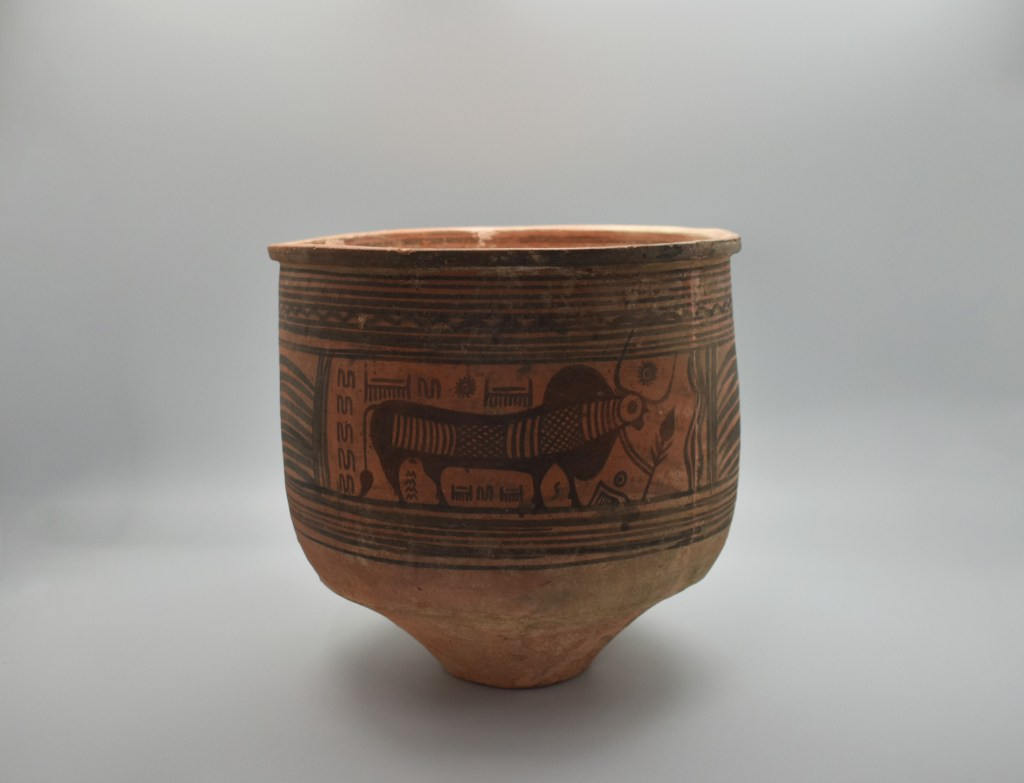 A painted jar from the Indus Valley Culture covered in glyphs