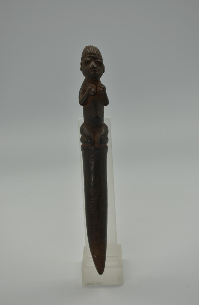 A plain wooden divination tapper from Africa