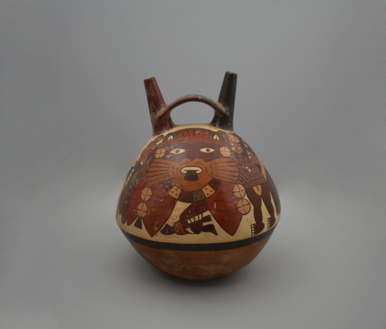 A stirrup spout jar featuring a painted, supernatural, feline-like being