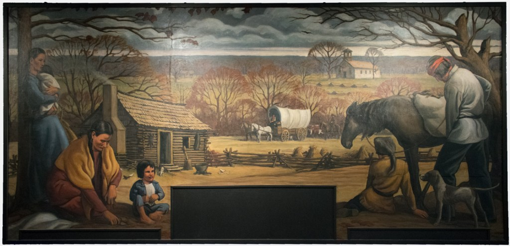 A large mural of a Choctaw homestead in McCurtain County by Louis Feund