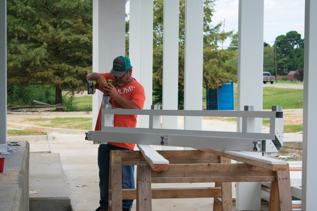 Contractor preparing a glass frame for installation