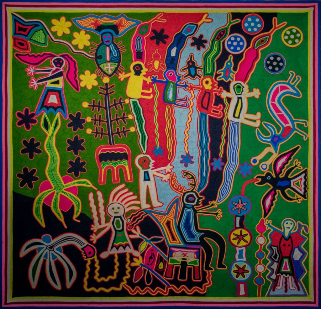 A multi-colored Huichol yarn painting inspired by peyote pilgrimages