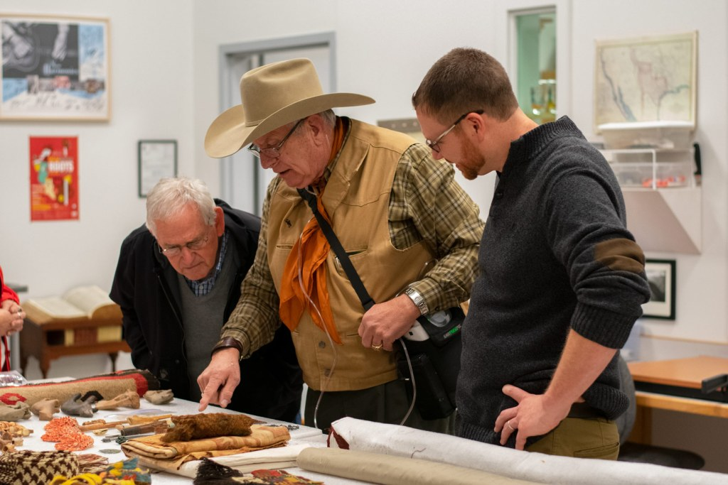 Men looking at artifacts