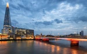 Illuminated London Bridge and Shard at night