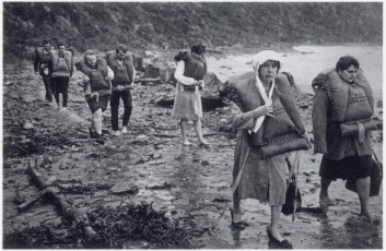 Shipwrecked passengers from TEV Wahine walking along Pencarrow coast