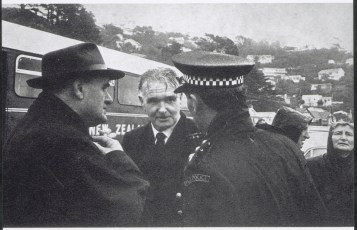Captain Robertson conferring with Marine Superintendent of Union Steam Ship Company, Captain Arthur Crosbie and a police officer