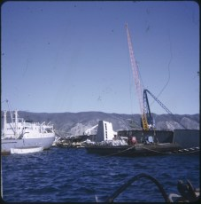 The salvage vessel Holmpark beside the TEV Wahine wreck