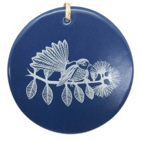 white fantail on blue ceramic hanging tile