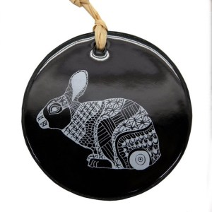 White bunny on black ceramic hanging tile