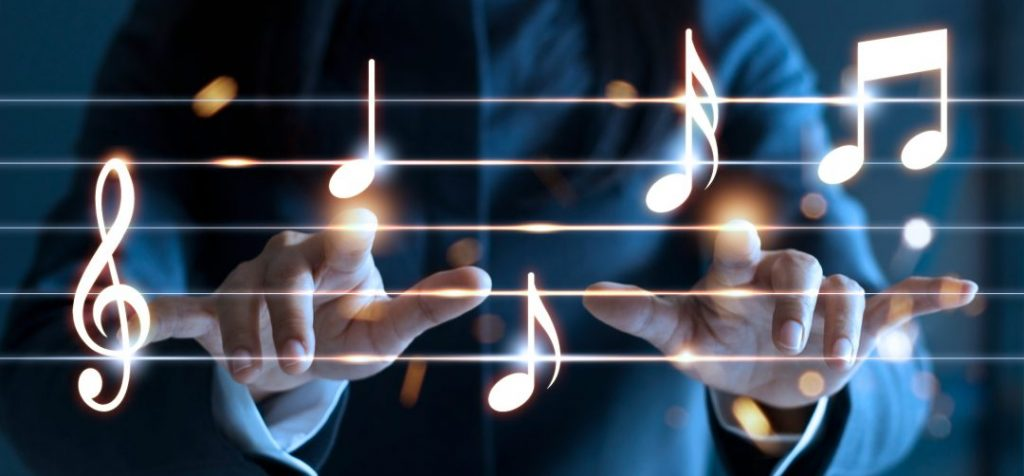 Decorative image of woman hands playing music notes on dark background, music concept