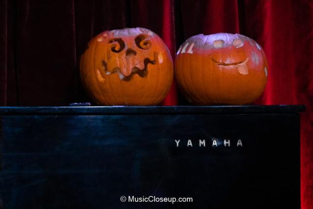 Carved Halloween pumpkins on a Yamaha piano
