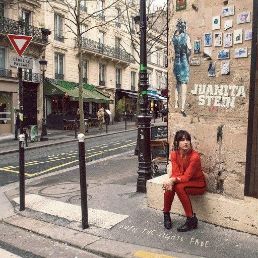 Juanita Stein sitting on a street corner