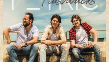 Petric album cover showing the three band members sitting down
