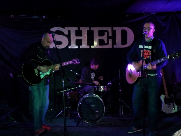 Flav Giorigi, Nik Coley and David James Wright on stage at The Shed.