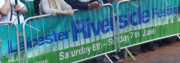 Banner in front of the main stage at the Riverside Festival