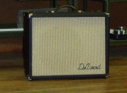 Although it has a DeArmond logo attached and a non-standard grille cloth, this in in fact a CF Martin Model 112. The DeArmond logo is appropriate in this case as this was Harry DeArmond's own amplifier, used regularly by him, photographed in the basement workshop of his home in Toledo, Ohio. Its serial number is F6 2013 (Serial number information courtesy of Charley Barnhart, Harry DeArmond's grandson.
