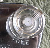 "Transparent cylindrical knob, fixed with slotted grubscrew: Note the gold-filled circle and marker line on the top of the knob. Fitted to Models FHC Guitar Mike. Another version of this knob, without a grubscrew, was fixed to a 1/4"" pot shaft on the controls for the early version of the Model 1000."