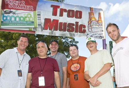 "The Troo Music Tent at the Bonnaroo featured Nashville bands The Features, The Protomen, and Heypenny. In addition to sharing Nashville roots, the three groups also won festival slots through ""The Road to Bonnaroo"" competition, co-sponsored by BMI, Bud Select, and venue partner, Mercy Lounge. Pictured at the Troo Music Tent are (l-r): BMI Sr. Dir., Writer/Publisher Relations Mark Mason, Bonnaroo co-founder and producer and AC Entertainment President Ashley Capps, Mercy Lounge GM Drew Mischke, BMI Dir. of Writer/Publisher Relations Bradley Collins, BMI Asst. VP Writer/Publisher Relations Clay Bradley, and BMI Assc. Dir., Writer/Publisher Relations Dave Claassen. Photo by Erika Goldring"