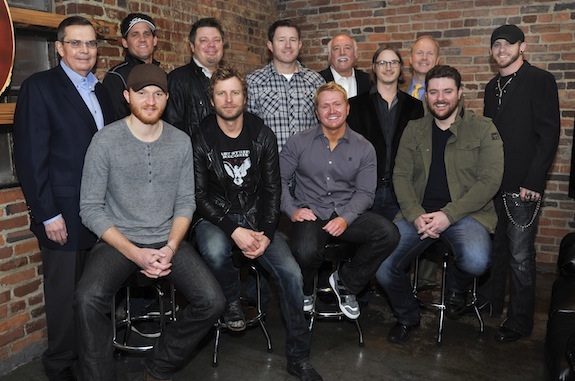 CMA leadership gathers with the newly named CMA Triple Play Award winning songwriters on Jan. 29, 2013 at Marathon Music Works in Nashville, Tenn. Back row (l-r): CMA Board President, Ed Hardy; Neil Thrasher; Rodney Clawson; Ben Hayslip; CMA Chief Executive Officer, Steve Moore; Josh Kear; CMA Board Chairman, Troy Tomlinson; and Brantley Gilbert. Front row (l-r): Eric Paslay; Dierks Bentley; Shane McAnally; and Chris Young. Photo credit: Donn Jones/CMA