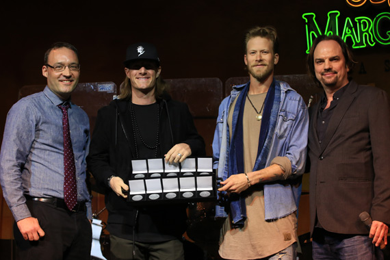 Florida Georgia Line accepts MusicRow No. 1 Challenge Coins for chart toppers on the CountryBreakout chart. Pictured (L-R): MusicRow's GM Craig Shelburne; Florida Georgia Line's Tyler Hubbard and Brian Kelley; MusicRow's Owner/Publisher Sherod Robertson.
