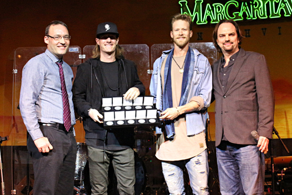 Pictured: FGL's Tyler Hubbard and Brian Kelley accept MusicRow No. 1 Challenge Coins to celebrate their chart-topping hits.