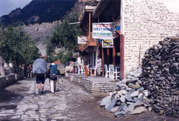 Billy and Raj walking along the Tukuche sidewalk