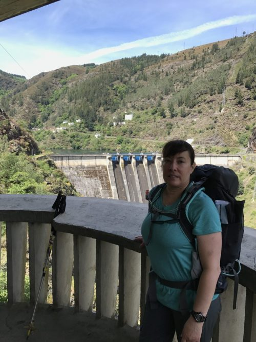 Irene standing on the lookout that overhangs the dam. Yes that is a look of pain.