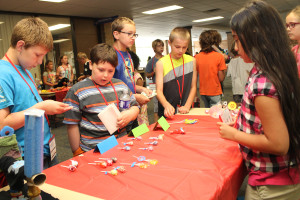 Students purchase lollipops from the young entrepreneurs during the WINGS program.