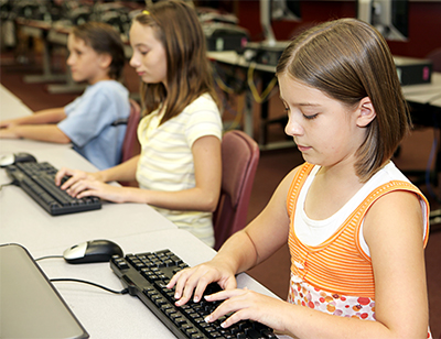 Young students working on computers