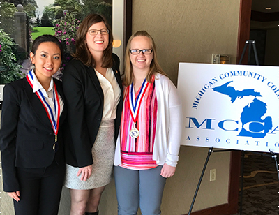 MCC students Van Vu (left) and Michaela Bosset (right), who were named to the 2017 All-Michigan Academic Team, pose with Dr. Lynn Tincher-Ladner, President and CEO of Phi Theta Kappa.