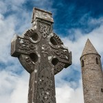 Celtic gravestone in front of Rattoo round tower in north Kerry, Ireland