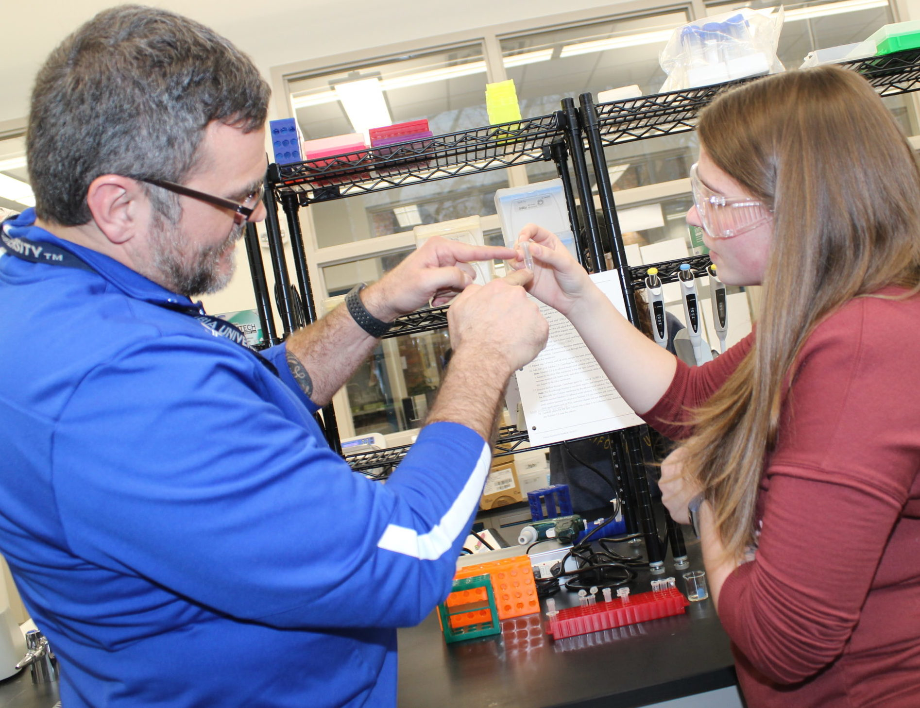 MCC Biology Instructor Darren Mattone with MCC student researcher Jordyn Hallberg in 2019. Hallberg is now studying biology at Central Michigan University.