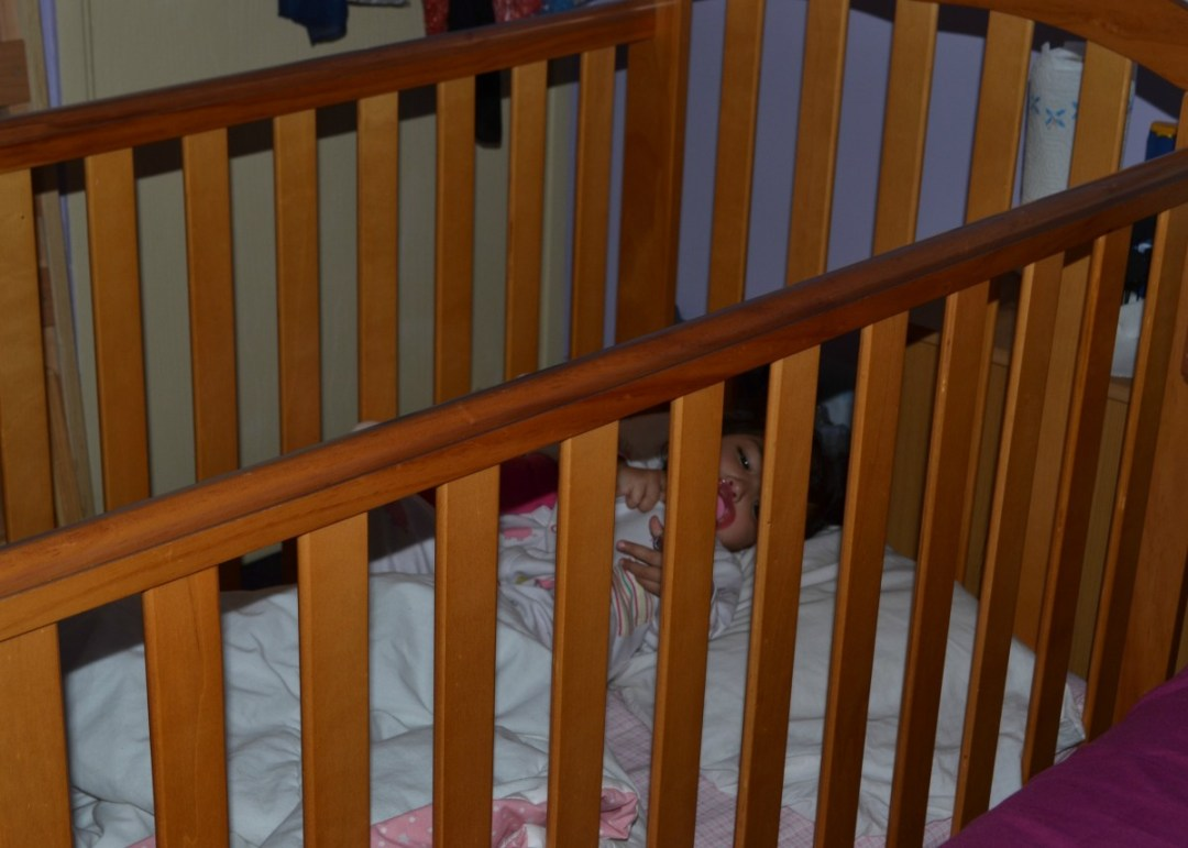 Having a nap in the cot