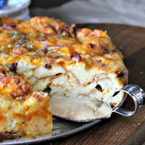 Cheddar Bacon Strata is a savory bread pudding/cake made with just 5 simple ingredients. Eggs, Bacon, cheese, bread and milk are what you need to make this delicious and gorgeous Strata. The Strata can be made a day ahead of time too! Click over for the complete recipe and easy instructions.