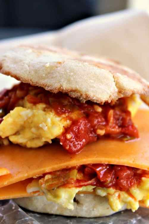 Egg and Cheese Breakfast Sandwich with Smoked Scallion Sauce is packed with flavor from the incredible smoky tomato sauce. Smoked paprika is the secret to the sauce! You will want to double the recipe to pile on burgers and steaks too!