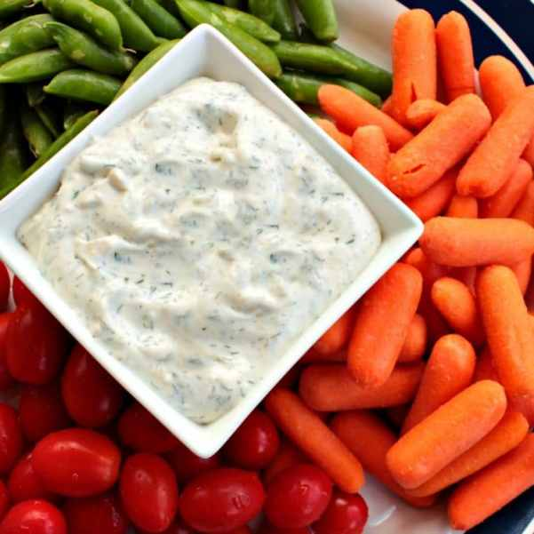 Easy Herb Dill Dip is a smooth, light dip seasoned with fresh herbs and spices. The secret to this amazing dip is that only sour cream is used for the base, no mayonnaise. Perfect as a dip for veggies, crackers and chips!