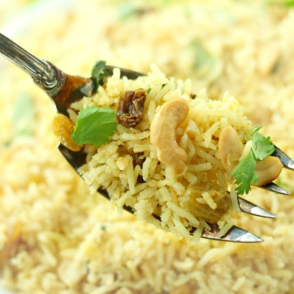 Red Curry Rice with Raisins and Cashews recipe is a quick, easy and spicy vegan meal.