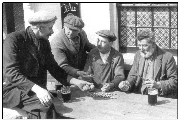 George 'Pop' Maynard (right) outside the pub at Tinsley Green, Sussex, 1936.  Photo from Keith Summers Collection via the Musical Traditions website.