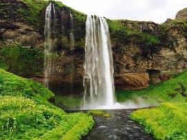 south-coast-waterfalls-glacier-hiking-lava-caving-plane-wreck-seljavallalaug-hot-pool-9