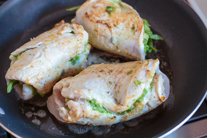 Pan sear the stuffed chicken breasts