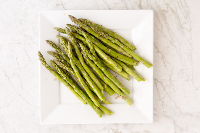 Asparagus seasoned with olive oil, salt and cracked pepper