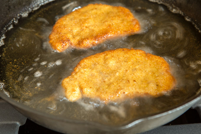 Frying the pork cutlets