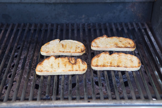 Grilling the sourdough slices for the grilled chicken Caesar sandwich