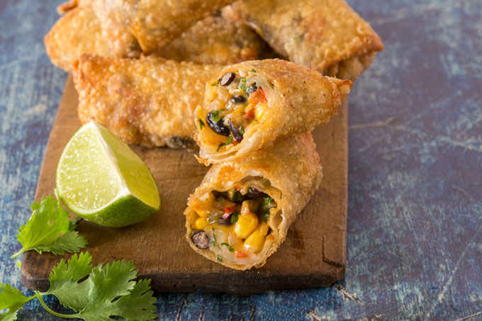 Southwest egg rolls on a cutting board
