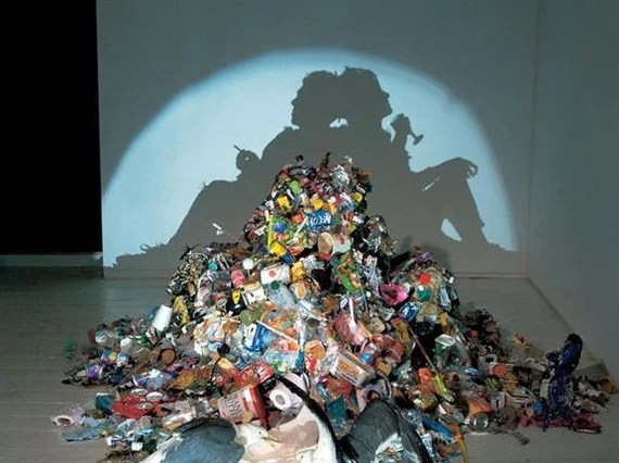 Dirty White Trash (With Gulls), 1998 6 months' worth of artists' trash, 2 taxidermy seagulls, light projector by Tim Noble and Sue Webster