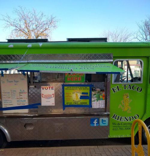 El Taco Riendo truck with Love Vote Rise poster