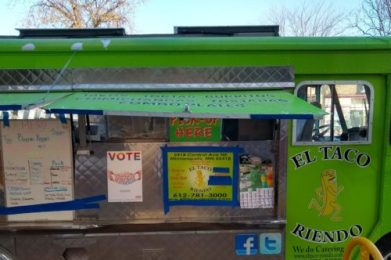 El Taco Riendo truck with Love Vote Rise poster