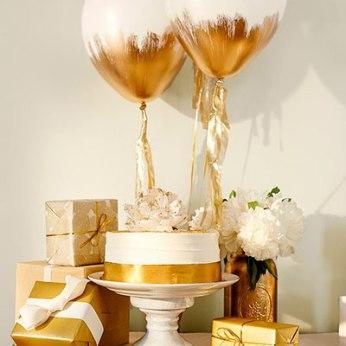 Manualidades para Baby Shower con globos dorados